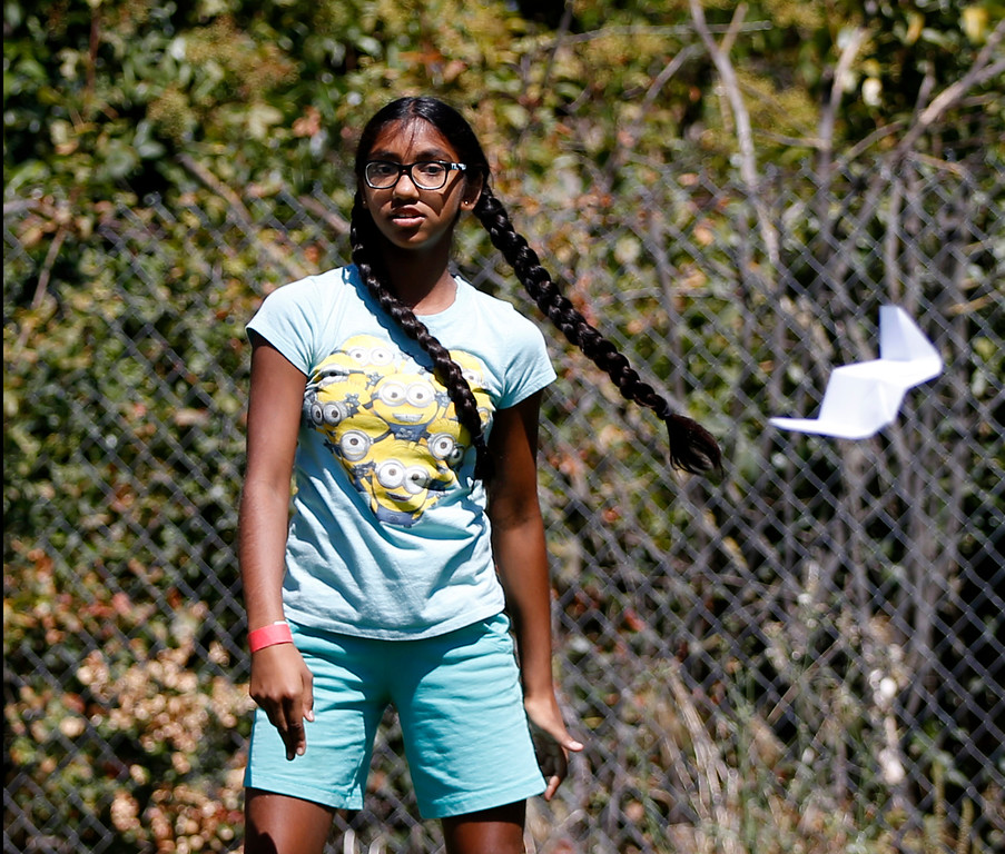 . Meena Kumar, 11, watches paper plane she made fly at the second annual San Jose Mini Maker Faire at History San Jose Park in San Jose, Calif., on Sunday, September 4, 2016. (Josie Lepe/Bay Area News Group)