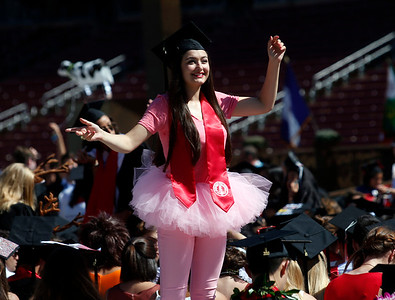 A Stanford University student in a pink tutu poses for a photograph during the school's traditional Wacky Walk entrance for their commencement ceremony in Stanford, Calif., Sunday morning, June 12, 2016. (Karl Mondon/Bay Area News Group)