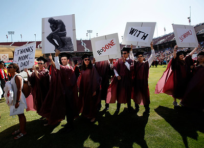 Stanford University students maintain the school's Wacky Walk tradition entering the football stadium for their commencement ceremony with academic puns in Stanford, Calif., on Sunday, June 12, 2016. (Karl Mondon/Bay Area News Group)