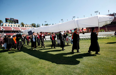 Stanford University students maintain the school's Wacky Walk tradition entering the football stadium in costume, some carrying mock rockets, for their commencement ceremony in Stanford, Calif., Sunday morning, June 12, 2016. (Karl Mondon/Bay Area News Group)