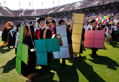 Stanford University students maintain the school's Wacky Walk tradition entering the football stadium in costume for their commencement ceremony in Stanford, Calif., on Sunday, June 12, 2016. (Karl Mondon/Bay Area News Group)