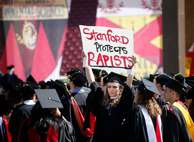 A graduating Stanford student holds a sign protesting the Brock Turner sentence during the start of the university's commencement ceremony in Stanford, Calif., Sunday morning, June 12, 2016. (Karl Mondon/Bay Area News Group)
