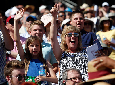 Family and friends wave to their graduates and take pictures during Stanford University's commencement ceremony in Stanford, Calif., Sunday morning, June 12, 2016. (Karl Mondon/Bay Area News Group)