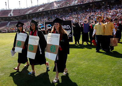 Stanford University students come as Starbucks coffee cups during the school's Wacky Walk tradition entering the football stadium for their commencement ceremony in Stanford, Calif., on Sunday, June 12, 2016. (Karl Mondon/Bay Area News Group)