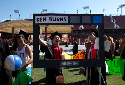 Two Stanford University students honor  Ken Burns, the documentary filmmaker who would later deliver the main address during the school's commencement ceremony in Stanford, Calif., Sunday morning, June 12, 2016. (Karl Mondon/Bay Area News Group)