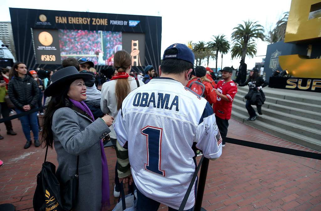 . Andy Duang, of San Jose, wears an Obama New England Patriots jersey at Super Bowl City in San Francisco, Calif., on Thursday, Feb. 4, 2016. (Jane Tyska/Bay Area News Group)