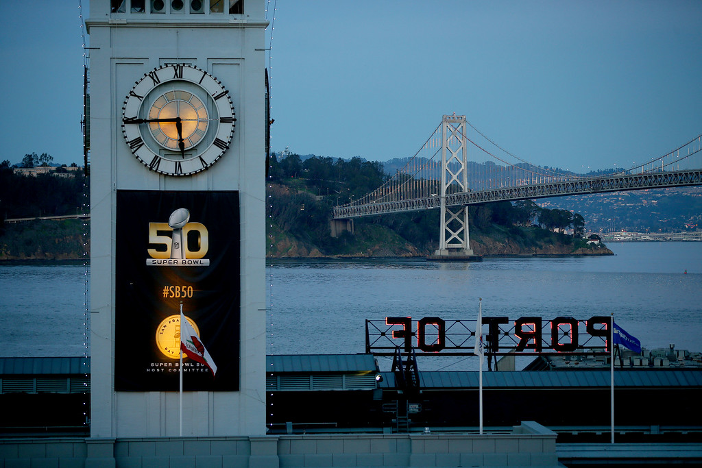 . The Super Bowl 50 logo is seen on the Ferry building with the Bay Bridge lights behind in San Francisco, Calif., on Thursday, Feb. 4, 2016. (Jane Tyska/Bay Area News Group)