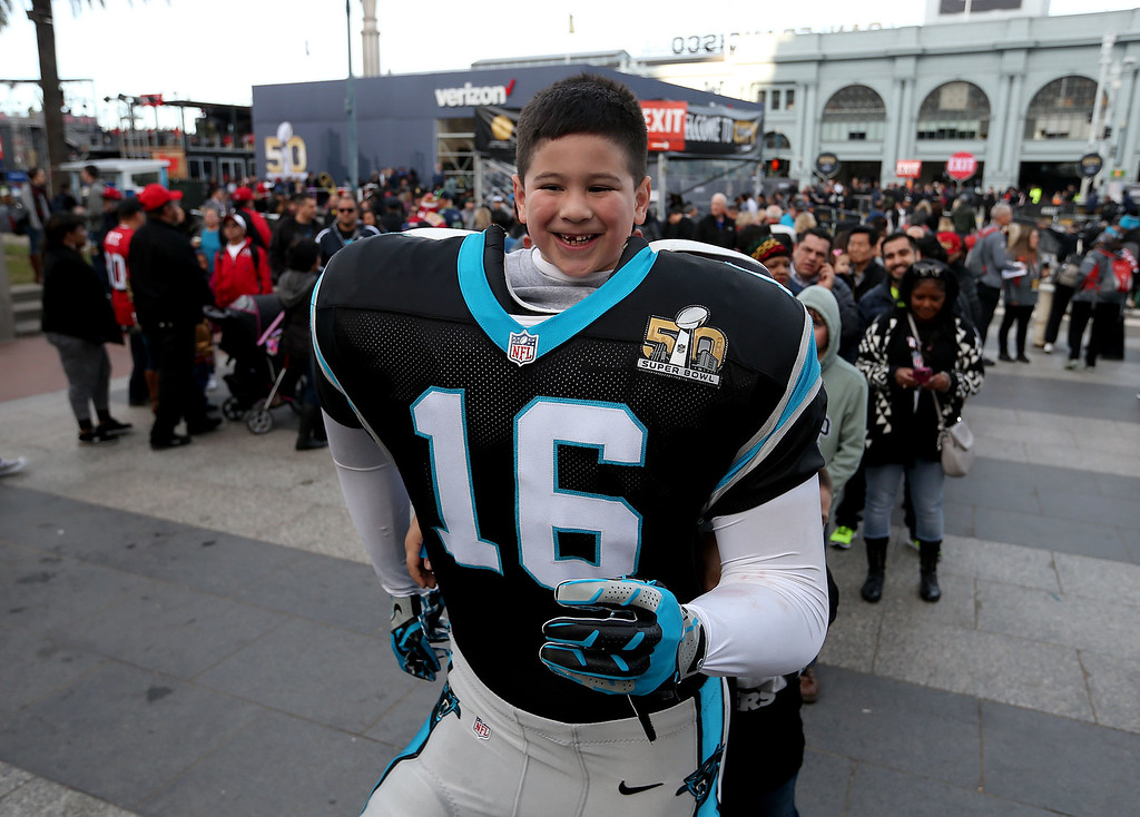 . Nathan Elizarrey, 6, of Hayward, poses for a picture with a Carolina Panther\'s uniform at Super Bowl City in San Francisco, Calif., on Thursday, Feb. 4, 2016. (Jane Tyska/Bay Area News Group)