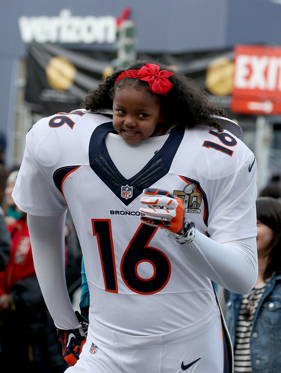 . Stephanie Cherry, 5, of Vallejo, poses for a photo with a Denver Broncos uniform at Super Bowl City in San Francisco, Calif., on Thursday, Feb. 4, 2016. (Jane Tyska/Bay Area News Group)