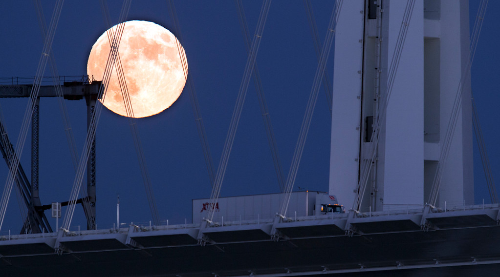 """. The full moon rises over the Bay Bridge, as seen from Treasure Island in San Francisco, Monday, Sept. 8, 2014. The full moon is the last so-called \""""supermoon\"""" of the summer. (D. Ross Cameron/Bay Area News Group)"""