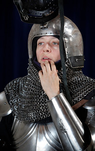 Skye Hilton slips into her suit of armour before a friendly clashing of the metal at the Davenriche European Martial Artes School in Santa Clara, Calif., Sunday, July 31, 2016.  (Karl Mondon/Bay Area News Group)
