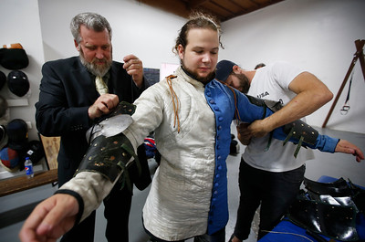 James Peters, a Campbell man living in Tokyo for the past few years, gets suited up in armor at the Davenriche European Martial Artes School in Santa Clara, Calif., Sunday, July 31, 2016, for an in-house tournament of armor-clad warriors testing their sword work against each other. (Karl Mondon/Bay Area News Group)