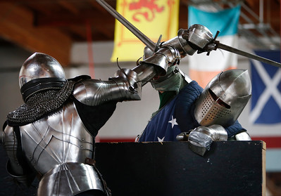 Skye Hilton, left, battles David Dixon during a friendly clashing of the metal at the Davenriche European Martial Artes School in Santa Clara, Calif., Sunday, July 31, 2016, during an in-house tournament featuring armor-clad warriors testing their strength against each other. (Karl Mondon/Bay Area News Group)