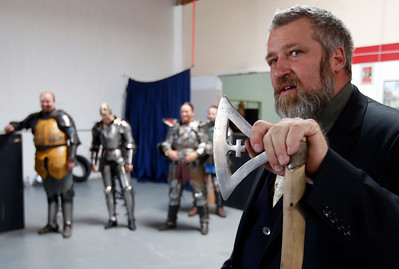 Steaphen Fink holds a 12th-century Danish axe replica at the Davenriche European Martial Artes School in Santa Clara, Calif., Sunday, July 31, 2016, where he conducted an in-house tournament of armor-clad warriors testing their strength against each other. (Karl Mondon/Bay Area News Group)