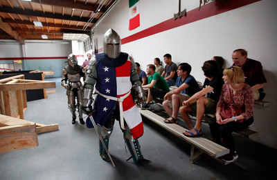 David Dixon, front, and Skye Hilton, walked through a group of spectators at the Davenriche European Martial Artes School in Santa Clara, Calif., Sunday, July 31, 2016, where an in-house tournament featuring armor-clad warriors was held. (Karl Mondon/Bay Area News Group)