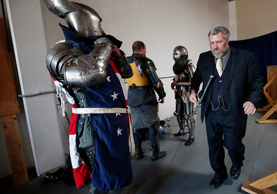 Steaphen Fink, right, walks past David Dixon getting suited up for a tournament at the Davenriche European Martial Artes School in Santa Clara, Calif., Sunday, July 31, 2016. (Karl Mondon/Bay Area News Group)
