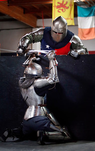 Skye Hilton, bottom, battles David Dixon during a friendly clashing of the metal at the Davenriche European Martial Artes School in Santa Clara, Calif., Sunday, July 31, 2016, during an in-house tournament featuring armor-clad warriors testing their strength against each other. (Karl Mondon/Bay Area News Group)