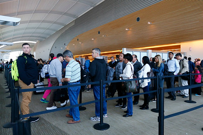 Passengers wait in line at the TSA security checkpoint at Terminal B in Mineta San Jose International Airport in San Jose, Calif., on Tuesday, April 12, 2016. A nationwide shortage of security personnel and the higher security level following the Belgium terrorist attacks has caused longer than usual boarding times. (Gary Reyes/Bay Area News Group)