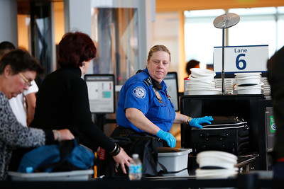 TSA personnel check bags at the security checkpoint in Terminal B at Mineta San Jose International Airport in San Jose, Calif., on Tuesday, April 12, 2016. A nationwide shortage of security personnel and the higher security level following the Belgium terrorist attacks has caused longer than usual boarding times. (Gary Reyes/Bay Area News Group)