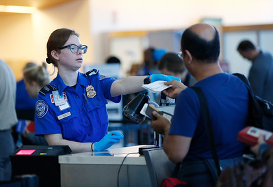 TSA personnel check documents at the security checkpoint in Terminal B at Mineta San Jose International Airport in San Jose, Calif., on Tuesday, April 12, 2016. A nationwide shortage of security personnel and the higher security level following the Belgium terrorist attacks has caused longer than usual boarding times. (Gary Reyes/Bay Area News Group)