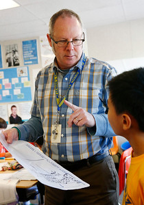 Derrall Garrison helps a student during a math lesson with his fifth grade class at R.I. Meyerholz Elementary School in San Jose, Calif., on Tuesday, March 15, 2016. The lack of affordable housing for teachers has led to teacher shortages and high turnover for schools in the Bay Area. Garrison commutes from Castro Valley because of the high cost of housing in Silicon Valley. (Gary Reyes/Bay Area News Group)