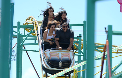Tony Valencia, front right, Julia Hernandez, front left, both from Fremont, Hena Sayed, 13, back left and Celine Chan, 13, back right, both from Dublin, yell as they ride The Zillerator at the Alameda County Fair at the Alameda County Fairgrounds in Pleasanton, Calif., on Wednesday, June 15, 2016. The fair, which opened on Wednesday with $1day, will run through July 4th. Check their website for hours and days of operation. (Dan Honda/Bay Area News Group)
