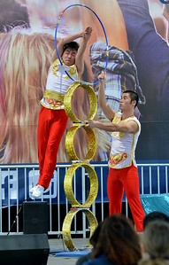 Ya ning Zhang, left, of the Chinese Acrobats of Hebei, leaps through a ring as part of their performance at the Alameda County Fair at the Alameda County Fairgrounds in Pleasanton, Calif., on Wednesday, June 15, 2016. The fair, which opened on Wednesday with $1day, will run through July 4th. Check their website for hours and days of operation. (Dan Honda/Bay Area News Group)