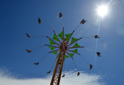 Fair goers ride the Vertigo at the Alameda County Fair at the Alameda County Fairgrounds in Pleasanton, Calif., on Wednesday, June 15, 2016. The fair, which opened on Wednesday with $1day, will run through July 4th. Check their website for hours and days of operation. (Dan Honda/Bay Area News Group)