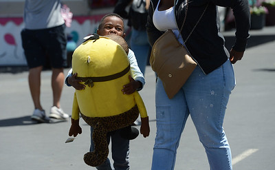 Part of the price of winning a large stuffed prize is having to carry it as Storm Johnson, 5, of Oakland, found out at the Alameda County Fair at the Alameda County Fairgrounds in Pleasanton, Calif., on Wednesday, June 15, 2016. The fair, which opened on Wednesday with $1day, will run through July 4th. Check their website for hours and days of operation. (Dan Honda/Bay Area News Group)