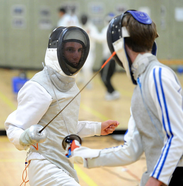 . Teva Venet, of Livermore, left, and Sam Brinker, of Pleasanton, have a fencing match using foils during the Las Positas Fencing Center\'s class for adults held at Las Positas College in Livermore, Calif., on Tuesday, July 9, 2013. The fencing center is operated through the Las Positas College Community Education program and offers instruction in foil, epee and saber. The center offers classes in all levels of fencing for adults and children over the age of 8. (Doug Duran/Bay Area News Group)