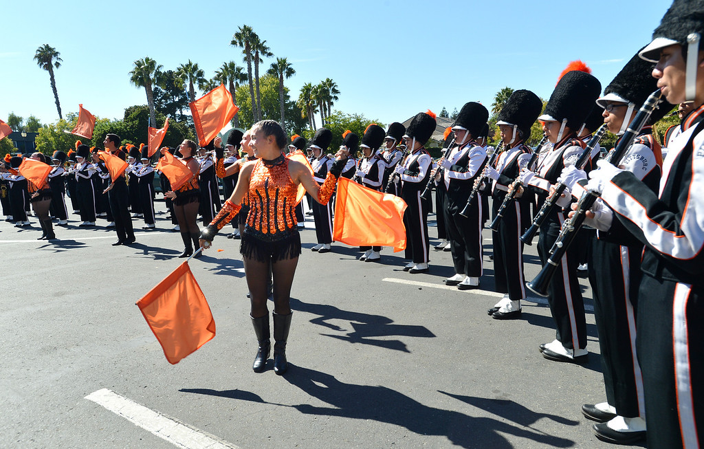 . The Pittsburg High Marching Show Band plays during the yellow duck races in Pittsburg, Calif., on Saturday, Sept. 28, 2013. The races benefit the Pittsburg Marching Show Band, which is trying to raise money so they can participate in the New Year\'s Day parade in London. (Dan Rosenstrauch/Bay Area News Group)