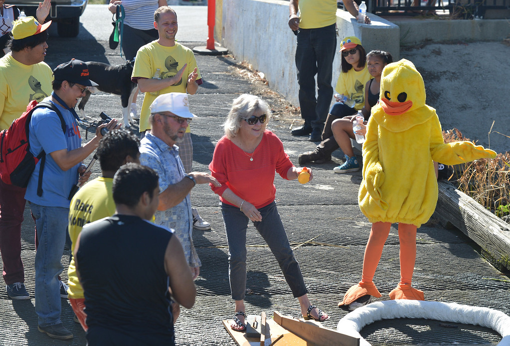 . Pittsburg Unified School District Superintendent Linda Rondeau holds up the winning yellow duck that belongs to the Pittsburg High Marching Show Band during the yellow duck races at Pittsburg Marina in Pittsburg, Calif., on Saturday, Sept. 28, 2013. The band won the grand prize, a restored 1979 Grand Ranchero restored by volunteers. The races benefit the Pittsburg Marching Show Band, which is trying to raise money so they can participate in the New Year\'s Day parade in London. (Dan Rosenstrauch/Bay Area News Group)