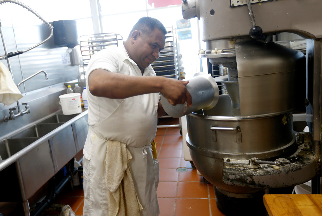 . Jose Martinez makes some dough at Tropicana Foods in San Jose, Calif., on Thursday, August 25, 2016. (Nhat V. Meyer/Bay Area News Group)