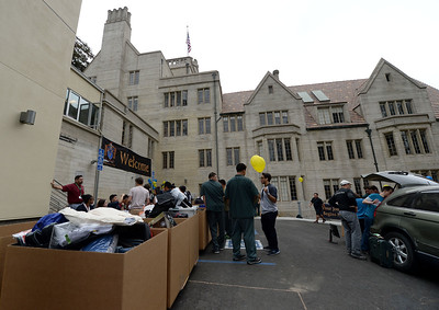 Students, family and staff hard at work during a move-in day at the newly restored Bowles Hall on the campus of UC Berkeley in Berkeley, Calif., on Saturday, Aug. 20, 2016. The castle-like building is part of a larger revival of the throw-back staples of college life at large research institutions that used these types of student residences to reinvigorate the intellectual and social lives of their students. This undertaking was a multimillion dollar effort. (Dan Honda/Bay Area News Group)