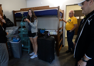 Roommates Vanessa Travieso, 19, far left, of Laguna Beach and Katie Willett, 18, right, of Turlock, and their family members, unpack in their room in the newly restored Bowles Hall on the campus of UC Berkeley in Berkeley, Calif., on Saturday, Aug. 20, 2016. The castle-like building is part of a larger revival of the throw-back staples of college life at large research institutions that used these types of student residences to reinvigorate the intellectual and social lives of their students. This undertaking was a multimillion dollar effort. (Dan Honda/Bay Area News Group)