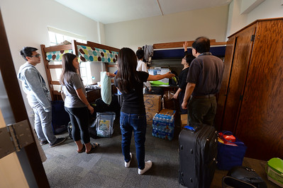 It is a two family job (they did not wish to be identified) to organize a room in the newly restored Bowles Hall on the campus of UC Berkeley in Berkeley, Calif., on Saturday, Aug. 20, 2016. The castle-like building is part of a larger revival of the throw-back staples of college life at large research institutions that used these types of student residences to reinvigorate the intellectual and social lives of their students. This undertaking was a multimillion dollar effort. (Dan Honda/Bay Area News Group)