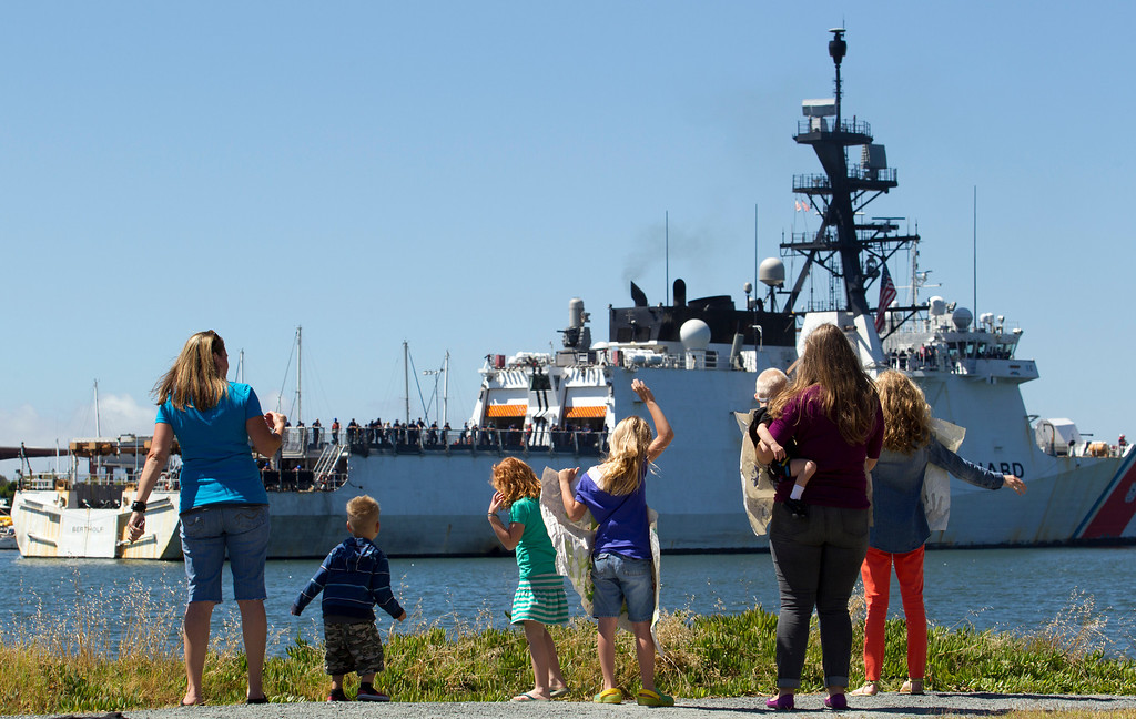 . Families and friends wave to their loved ones aboard the USCG Cutter Bertholf as it returns to port on Thursday, Sept. 5, 2013, on Coast Guard Island in Alameda, Calif. The crew of more than 100 seamen returned from a 160-day deployment to the eastern Pacific Ocean. (D. Ross Cameron/Bay Area News Group)