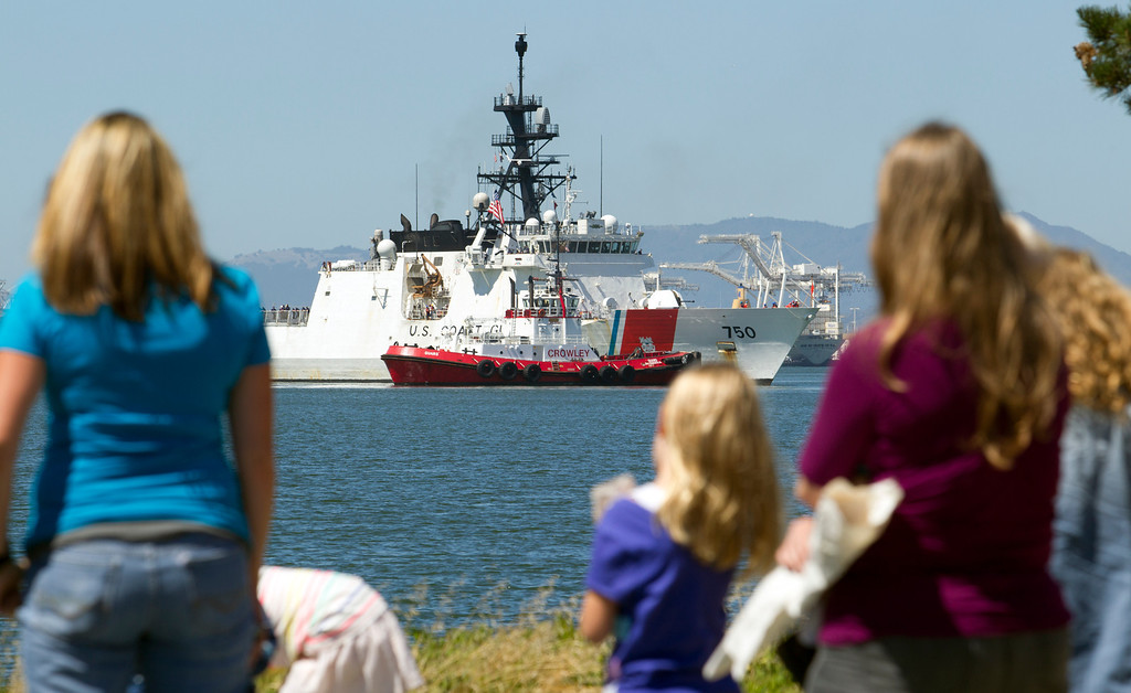 . Families and friends wait on the pier for the return of the USCG Cutter Bertholf on Thursday, Sept. 5, 2013, on Coast Guard Island in Alameda, Calif. The crew of more than 100 seamen returned from a 160-day deployment to the eastern Pacific Ocean. (D. Ross Cameron/Bay Area News Group)