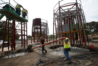 Crews install a new Swedish-made playground structure in Beresford Park in San Mateo, Calif., Tuesday morning, May 10, 2016. (Karl Mondon/Bay Area News Group)