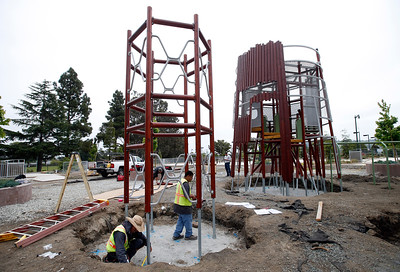 Francisco Torres, left, and Sabian Gonzalez install a new Swedish-made playground structure in Beresford Park in San Mateo, Calif., Tuesday morning, May 10, 2016. (Karl Mondon/Bay Area News Group)