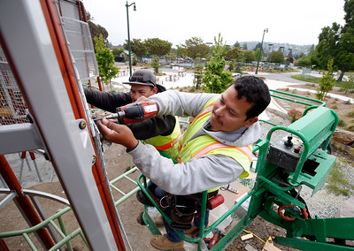 Miguel Angel Uribe installs a screen on a new Swedish-made playground structure in Beresford Park in San Mateo, Calif., Tuesday morning, May 10, 2016. Helping him is Jorge Hernandez. (Karl Mondon/Bay Area News Group)