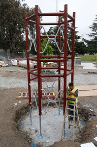 Sabian Gonzalez installs a new Swedish-made playground structure in Beresford Park in San Mateo, Calif., Tuesday morning, May 10, 2016. (Karl Mondon/Bay Area News Group)
