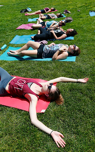 Bailey Taunt, foreground, enjoys yoga in the sunshine during a group class in the quad at San Jose State University, in San Jose, Calif., on Wednesday, April 6, 2016. Be the Change Yoga holds a free class on campus once month for students and the public. (Gary Reyes/Bay Area News Group)