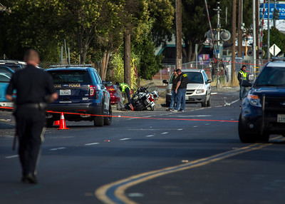 Investigators study the scene were veteran San Jose police motorcycle officer Michael J. Katherman was killed after being hit by a minivan on Commercial Street near Horning Street in San Jose, Calif., on Tuesday, June 14, 2016. (LiPo Ching/Bay Area News Group)