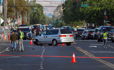 A minivan sits on Commercial Street near Horning Street after hitting and killing veteran San Jose police motorcycle officer Michael J. Katherman in San Jose, Calif., on Tuesday, June 14, 2016. (LiPo Ching/Bay Area News Group)
