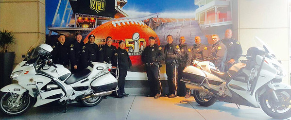 Courtesy April Katherman — San Jose police officer Michael Katherman, center right, is pictured with other members of the San Jose Police Department. Katherman, a San Jose motorcycle officer, died June 14, 2016 from injuries he suffered when he was hit on North Tenth Street near Horning Street by another motorist.