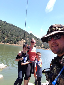 Courtesy April Katherman — San Jose police officer Michael Katherman, right is pictured in a family 'selfie' photo with his wife April and their two sons, whose names and ages were not provided, on a fishing trip. Katherman, a San Jose motorcycle officer, died June 14, 2016 from injuries he suffered when he was hit on North Tenth Street near Horning Street by another motorist.