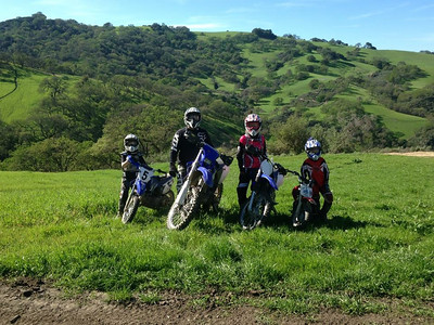 Courtesy April Katherman — San Jose police officer Michael Katherman is pictured in a family photo with his two sons and another unidentified youth, all of whom whose names and ages were not provided. Katherman, a San Jose motorcycle officer, died June 14, 2016 from injuries he suffered when he was hit on North Tenth Street near Horning Street by another motorist.