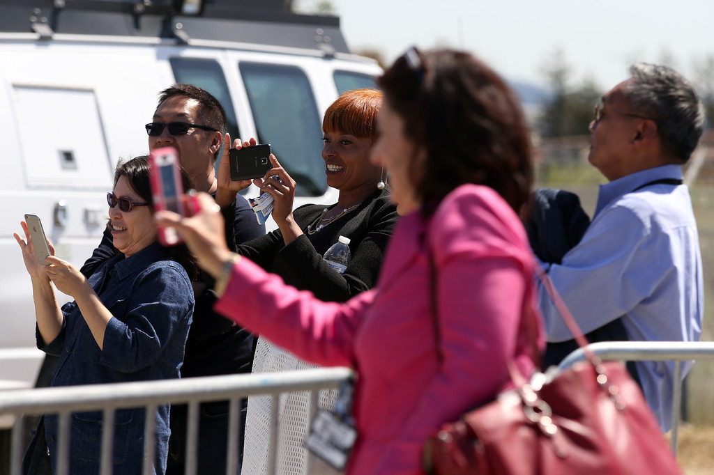 . Attendees photograph as Vice President Joe Biden\'s motorcade leaves after his remarks on the importance of workforce development and investing in job-training programs during a visit to a Pacific Gas and Electric Company service center in Oakland, Calif., April 10, 2015. PG&E�s PowerPathway program is helping workers obtain skills for entry-level positions in the utility industry. Since the program�s debut in 2008, 600 individuals have graduated from the program, including 300 veterans, and 80 percent have been hired into PG&E or the utility industry. (Anda Chu/Bay Area News Group) is introduced by PowerPathway program student and veteran Elizabeth Torres, of San Francisco, during a visit to a Pacific Gas and Electric Company service center in Oakland, Calif., April 10, 2015. PG&E�s PowerPathway program is helping workers obtain skills for entry-level positions in the utility industry. Since the program�s debut in 2008, 600 individuals have graduated from the program, including 300 veterans, and 80 percent have been hired into PG&E or the utility industry. (Anda Chu/Bay Area News Group)