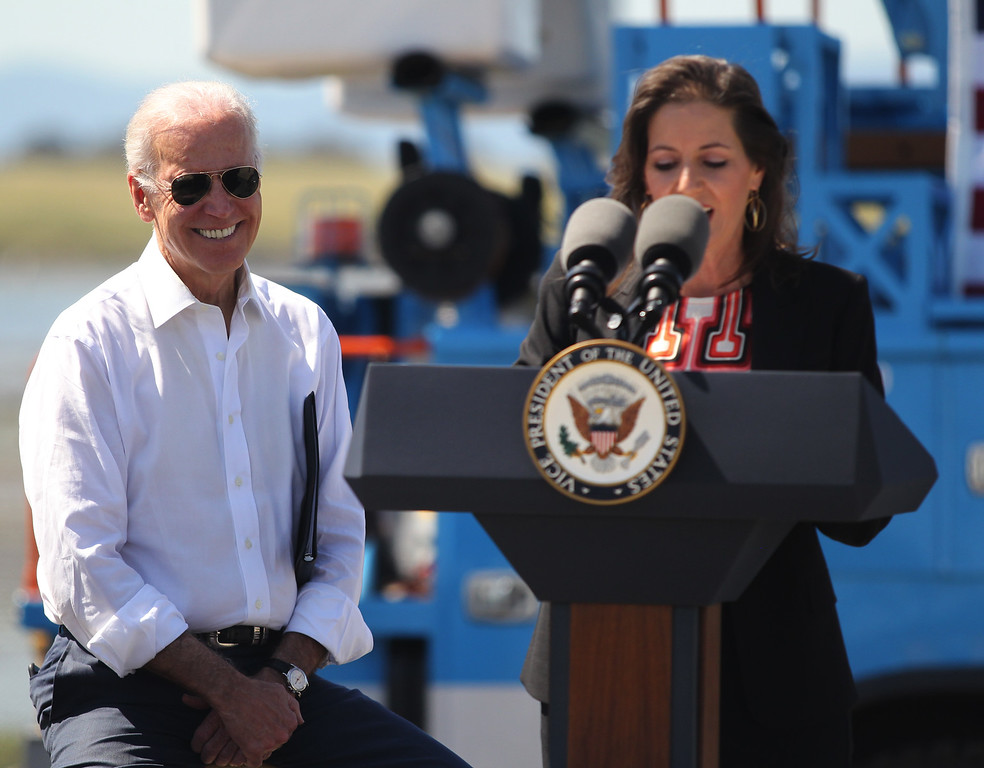 . Vice President Joe Biden listens to Oakland Mayor Libby Schaaf before discussing the importance of workforce development and investing in job-training programs during a visit to a Pacific Gas and Electric Company service center in Oakland, Calif., April 10, 2015. PG&E�s PowerPathway program is helping workers obtain skills for entry-level positions in the utility industry. Since the program�s debut in 2008, 600 individuals have graduated from the program, including 300 veterans, and 80 percent have been hired into PG&E or the utility industry. (Anda Chu/Bay Area News Group)